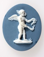 Oval blue jasper medallion with white relief of Cupid burning a butterfly. In Greek mythology the butterfly is said to represent the human soul and as such the burning of the butterfly  represents the destructive powers of love.