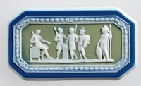 Octagonal tri-color jasper (dark blue, sage green, and white) cameo with white relief Marcus Scoevola before King Porsena, featuring four warriors, a fire in the centre and one man sitting on a chair.