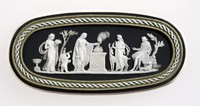 Oval tri-color jasper (black, sage green, and white) cameo with white relief featuring the Sacrifice to Diana. Diana being the goddess of hunting and chastity and can be seen with a deer next to her.