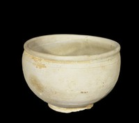 Bowl with rolled rim, with bluish glaze in well and gray clay