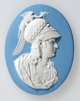Oval blue jasper medallion with white relief profile portrait of Alexander the great (356-323 BC). Alexander was a Greek soldier, son of Philip of Macedon, born in Pella, and educated by Aristotle. At an early age he showed military talent of a high order, crossing the Hellespont in 334 to defeat a Persian army led by Darius. He consolidated this victory by occupying Palestine, marching thence to Egypt where he was hailed as a deliverer from Persian tyranny. He founded Alexandria in 331 B.C., and again defeated Darius in the same year. By 329 he had reached the river of Jaxartes, and in 328 subdued the whole of Sogdiana. In 326 he attempted the conquest of India, establishing Greek colonies in the Punjab, and bringing Greek influence to the art in the East, Returning to Babylon he began to plan for further conquests, but was taken ill after a banquet and died eleven days later. His body deposited in Alexandria in a soldiers coffin.