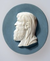 """Oval blue jasper medallion with white relief profile portrait of Euclid facing left, Greek mathemetician also referred to as the """"father of geometry"""" active in Alexandria during the reign of Ptolemy I (323 - 283 B.C.E). His Elements is one of the influential works in the history of mathematics, serving as the main textbook for teaching mathematics especially geometry from the time of its publication until the late 19th or 20th century. In the Elements, Euclid deduced the principles of what is now called Euclidean geometry from a small set of axioms. Euclid also wrote works on perspective, conic sections, spherical geometry, number theory and rigor."""