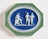 Octagonal tri-color jasper (sage green, dark blue, and white) jasper cameo with white relief scene of three men decorated by Bert Bentley.