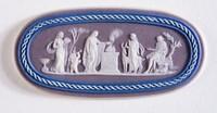 Oval tri-color jasper (lilac, dark blue, and white) cameo with white relief sacrificial scene