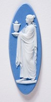 Elongated oval light blue cameo with white relief woman holding urn probably containing ashes