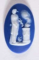Oval dark blue jasper dip front and back with polishing to sides cameo with white relief of A sacrifice to Hygeia