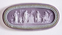 Oval tri-color jasper (lilac, sage green, and white) cameo with white relief sacrificial scene