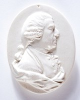 Oval medallion with relief profile of Lord Samuel Hood (1724-1816), British Admiral, Born in Dorset, Entering the Navy in 1741; promoted post captain in 1759; commissioner of Portland dockyard 1778; served with Lord Rodney in the West Indies, 1780-1783, for which he was promoted commander-in-chief. In his actions in the West Indies against the French commander, de Grasse, Hood showed himself a masterly tactician. He stood for Parliament in 1784 against Fox for Westminster and was elected.