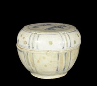 Covered box with underglaze cobalt painting with stylized landscape on flat top.