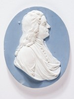 Oval gray-blue jasper medallion with white relief profile portrait of Sir Isaac Newton (1642-1727) was an English natural philosopher and mathematician. Newton's formulation of the law of gravity from observing the fall of an apple came in 1666. He went on to devise a reflecting telescope and study Descartes' geometry. His most important published work is the Principia mathematica of 1684. His Optics first appeared in 1704. He is buried in Westminster Abbey.