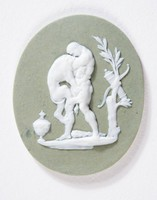 Oval green jasper medallion with white relief of Hercules and the nemean lion