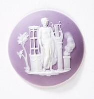Round lilac jasper medallion with white relief sacrificial scene