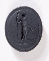 Oval black basalt intaglio with standing male nude holding spear