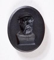 Oval black basalt intaglio with portrait of Homer on square plinth
