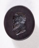 Oval black basalt intaglio with profile portrait of a bearded man