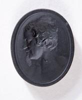 Oval black basalt intaglio with profile portrait of bearded man
