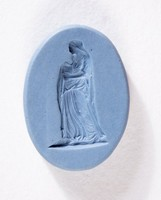 Oval medium blue jasper intaglio with standing female figure