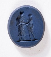 Oval dark blue jasper intaglio with two robed figures
