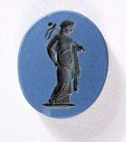 Oval blue jasper Nicolo intaglio with black figure holding banner