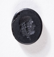 Oval black basalt intaglio, two-sided with profile portraits of bearded men on each side