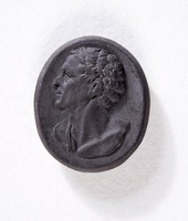 Oval black basalt cameo with profile portrait of a man