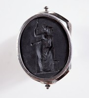 Oval black basalt intaglio, two-sided with profile portrait of woman on one side and Roman figure on the other, set in a rotating metal shank