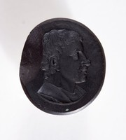 Oval self-shanked black basalt intaglio with profile portrait of man's head, large chip to edge back of head