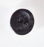 Oval self-shanked black basalt intaglio seal with profile portrait of man's head