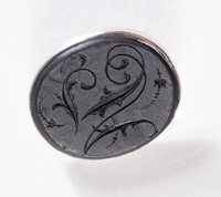 Oval black basalt intaglio or cypher set in silver as a button