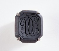 Octagonal black basalt intaglio or cypher set in sterling silver as a button