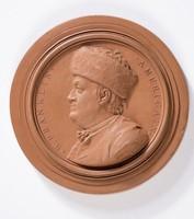 Round terracotta medallion with profile portrait of Benjamin Franklin