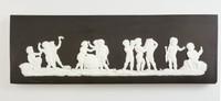 Rectangular black jasper plaque with white relief scenes of Cupids in the arts