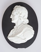 """Black jasper medallion with white relief profile portrait of John Locke (1632-1704), was an English philosopher and physician, widely regarded as one of the most influential of Enlightenment thinkers and commonly known as the """"Father of Liberalism"""".Considered one of the first of the British empiricists, following the tradition of Sir Francis Bacon, he is equally important to social contract theory. His work greatly affected the development of epistemology and political philosophy. His writings influenced Voltaire and Jean-Jacques Rousseau, many Scottish Enlightenment thinkers, as well as the American revolutionaries. His contributions to classical republicanism and liberal theory are reflected in the United States Declaration of Independence."""