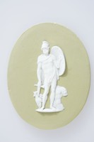 Small, oval plaque of white jasper with peach-green jasper dip and white relief decoration with the figure of Mars with shield and sword and with armor and a rooster at his feet.