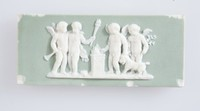"""Small, rectangular plaque of white jasper with green jasper dip and white relief decoration with the scene """"Sacrifice to Hymen."""""""