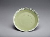 Green jasperware saucer with white relief leaf border