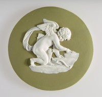 Round green jasper medallion with white relief of Cupid sharpening his arrows Cupid also known as Eros or Amor, The god of Love, he is often seen portrayed with a bow and arrows in order to strike with his 'cupid's darts.
