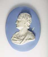 Oval blue jasper medallion with white relief profile portrait of Newton with a 'shooting star' on the right with a blue background, white portrait.(1642-1727) was an English natural philosopher and mathematician. Newton's formulation of the law of gravity from observing the fall of an apple came in 1666. He went on to devise a reflecting telescope and study Descartes' geometry. His most important published work is the Principia mathematica of 1684. His Optics first appeared in 1704. He is buried in Westminster Abbey.