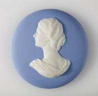 Round blue jasper medallion with white relief profile portrait of Miss Wegwood