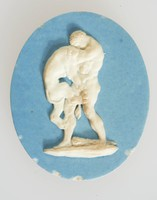 Oval blue jasper cameo with white relief scene of Hercules slaying the Nemean lion, in wood frame