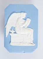 """Eight-sided (cut corners) blue jasper plaque with white relief of the recording angel assigned by God to go and record events, actions and or prayers of each individual human. In the Book of Malachi 3:16, the prophet described Heaven as having conferring angels and """"The LORD took note and listened, and a book of remembrance was written before hims of those revbered the LORD and thought on his name."""