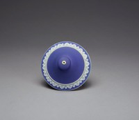 Cover for a pot, bowl or dish of white jasper with dark blue jasper dip and white relief decoration, the domed cover with a band of overlapping acanthus leaves in white relief, with some shading, the mushroom finial with a white hole in the top.