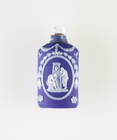 Dark blue jasper perfume bottle with white relief scene of Hope with anchor on one side, and figures mourning warrior on the other, with crystal stopper