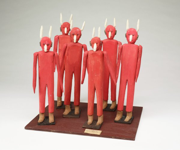 Six devils mounted on one board.