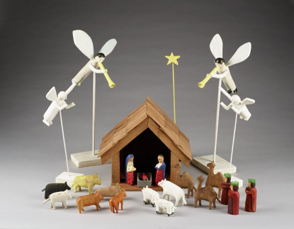 Multiple pieces, manger, Mary, Joseph, Jesus, animals, three kings with camels, and four angels.