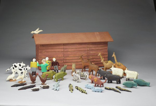 Brown ark with dove on roof, Noah and his wife, boy and girl, and 19 pairs of animals.
