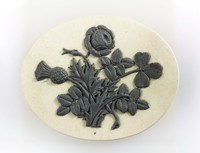 Oval white jasper medallion with black relief of thistle, rose and shamrock