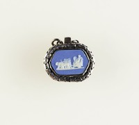 Six-sided dark blue jasper cameo with white relief decoration, set in cut steel and silver(?) as a chatelaine, bracelet, or watch fob element