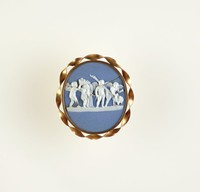 Round blue jasper cameo with white relief of the marriage of Cupid and Psyche, set in twisted gold colored metal mount as brooch, cracked