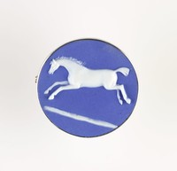 Round dark blue jasper cameo with white relief of leaping horse (after Burch?), set in silver metal as a brooch